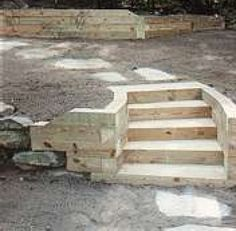 How to Build a Timber Retaining Wall.  Great look timber steps, inbuilt into retainer to access different levels.