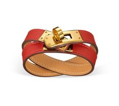 """Kelly Double Tour Hermes leather bracelet (size S) Capucine red swift calfskin Gold plated hardware, 14.5"""" long, 2.25"""" diameter, 0.5"""" wide"""