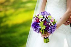 Purple and green themed bridal bouquet created by Lexington Floral in Shoreview, Minnesota.  #weddingflowers #bridalbouquet