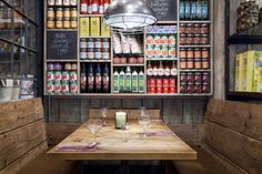 i like this with its rustic look and very corner store-colorful display wall