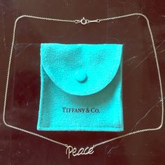 "TIFFANY & CO. Paloma Picasso ""peace"" necklace 16"" This is an authentic Tiffany & Co. Paloma Picasso sterling silver ""peace"" necklace. bought at the Phipps Plaza Atlanta Tiffany & Co. store. Rare find. Beautiful and a great message. 16"". Comes with blue felt Tiffany & Co. bag shown. Price firm. Guaranteed authentic.  This does not qualify for bundle discount. Tiffany & Co. Jewelry Necklaces"