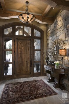 Traditional Entryway with specialty door, Standard height, can lights, Transom window, Concrete tile , Exposed beam