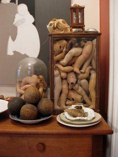 Doll parts in jars