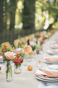 onelove photography has done it yet again with this orange themed bash set in the woods of California. It's as bright and coral-infused as can be (which we love), has a playful air about it (which . Outdoor Wedding Tables, Simple Wedding Reception, Outdoor Table Settings, Wedding Table Settings, Simple Weddings, Rustic Weddings, Summer Wedding, Fall Wedding Centerpieces, Wedding Table Flowers