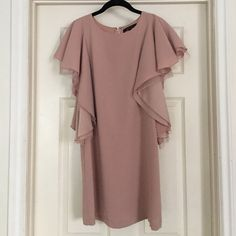 BCBG light Pink/Nude Party Dress Gorgeous light pink/nude dress with ruffle sleeves. Only worn a few times. No trades, best offers usually accepted. BCBGMaxAzria Dresses Mini