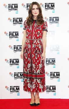 Keira Knightley wears a printed dress with classic pumps