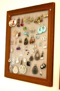 DIY earring organizer using an old frame and screening