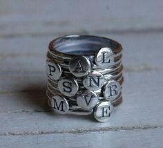 "inexpensive and cute way to have all your kids initials stacked as a ""mom's"" ring!! Alphadot Sterling Silver Stackable Letter Ring. $16.00, via Etsy."