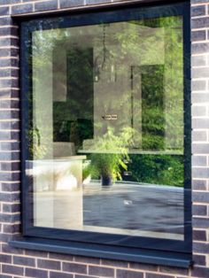 For a truly unique and modern look, this new flush glazed window system utilises modern bonding solutions to create a watertight window system with wall-to-wall glass. this contemporary window design utilises back painted glass to conceal the aluminium framing behind the glass pane. A thermally broken aluminium framing profile and argon gas cavity ensure the system achieves high thermal performance levels. For more information, visit the Sieger website. Glass And Aluminium, Aluminium Windows, Contemporary Windows, Back Painted Glass, Behind The Glass, Roof Light, Window Design, Art And Technology, Traditional