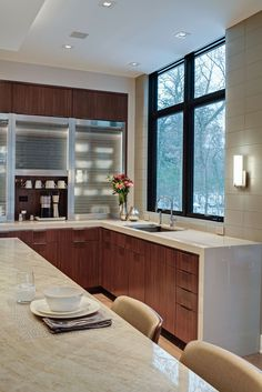 Streamlined Natural Walnut - Grabill Cabinets | Designed by Drury Design | Contemporary Kitchen