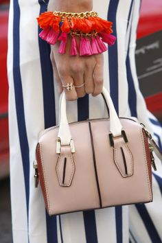 How adorable is this miniature handbag, we're loving the brightly coloured tassel jewellery too #MFW #AW14