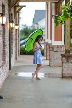 Rainy Day outfit in Alabama! Summer perfect look with a monogrammed umbrella, lace-up striped dress and bow sandals. #HelloGorgeous