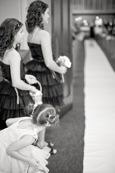such a cute moment captured in anticipation of the Bride's big entrance  Photography by http://mthreestudio.com