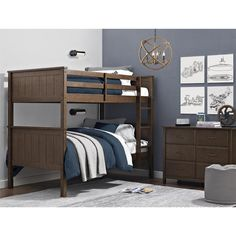 Crafted with a sturdy wood construction, this bunk beds traditional design features subtle rustic-inspired aesthetics such as a mocha finish, charming vertical wood paneled details on both the headboa