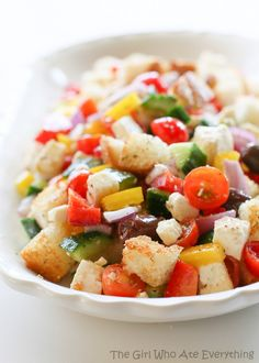 Greek Panzanella Salad - for those of you who like the toppings more than the actual salad.  {The Girl Who Ate Everything}