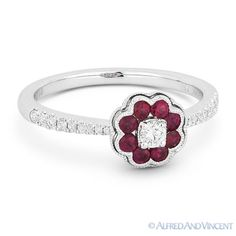 The featured ring is cast in 18k white gold and showcases a flower design set with round cut ruby petals & round cut diamonds at the center and halfway along the band.