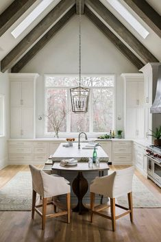 Kitchen with Vaulted Ceiling Picture. Kitchen with Vaulted Ceiling Picture. White Contemporary Kitchen with Vaulted Ceilings Home Decor Kitchen, Rustic Kitchen, Kitchen Design, Vaulted Ceiling Kitchen, Vaulted Ceilings, Sloped Ceiling, White Contemporary Kitchen, Kitchen With High Ceilings, Style Tile