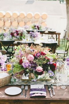 Table setting in pink's and mauve with menu. #centerpiece    Read More: http://www.stylemepretty.com/2014/10/29/vintage-chic-winery-wedding-with-pops-of-purple/