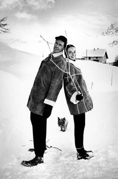 Mel Ferrer and Audrey Hepburn pose in the snow with their dog Mr. Famous in St Moritz, Switzerland, 1958