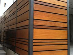 A unique combination of stained Mangaris lumber and Kynar-painted steel posts defines this Manhattan Beach, California fence from Ecocentrix Landscape Architecture .
