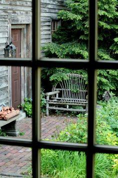 garden bench window view^