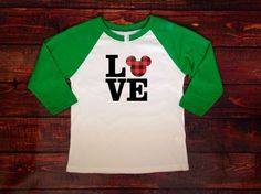 A personal favorite from my Etsy shop https://www.etsy.com/listing/491012171/love-mickey-raglan-shirt-disney-long