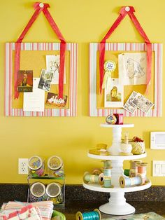 wrap a frame in fabric, hot glue fabric to the back of frame, pull tight as you go. hot glue corkboard cut to size to back of frame. attach 2 lengths of matching ribbon to top with sm nails, letting ends hang over front. hang side by side