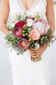 Rustic protea and Australian native wedding bouquet in shades of pink. Inspiration for wedding flowers. Proteas are a great flower to include in your bridal bouquet and centerpieces. Protea Wedding, Red Bouquet Wedding, Rustic Wedding Flowers, Wedding Flower Arrangements, Bride Bouquets, Bridal Flowers, Floral Wedding, Wedding Colors, Colourful Wedding Flowers