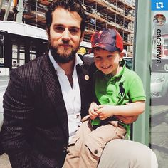 Henry Cavill with this darling little boy this morning in Jersey! His mum @oscarewa gave us the okay to share this photo. ❤️・・・Meeting the most sexy man alive !!! Unfortunately my phone was packed with data and I couldn't take anymore pics! I could cry!! but least his little fan had one and he make him very happy as appears Henry is best friends with Captain America . He's really nice guy! #superman #henrycavill #handsome #sweet