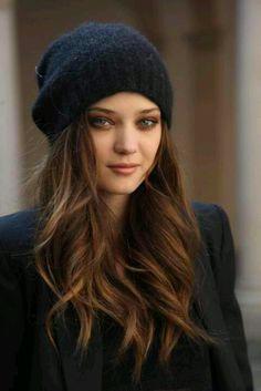 long hair, stocking cap, and loose curls
