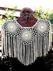 An intricate shrug with an almost Southwest-like quality to it. This beautiful shrug is a perfect summer accessory. The motifs circle the shoulders with the fringe adding length to the design. One size fits most and it only takes 2 skeins of Mimosa. Annie's Crochet, Crochet Shrug Pattern, Crochet Tunic, Wrap Pattern, Crochet Scarves, Crochet Crafts, Crochet Clothes, Crochet Projects, Crochet Patterns