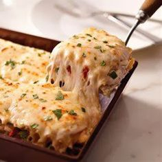 Creamy white chicken alfredo lasagna Creamy Chicken Alfredo Lasagna 2 c shredded cooked chicken breasts 1 can (14 oz.) artichoke hearts, drained, chopped 1 pkg. (8 oz.) KRAFT Shredded Mozzarella Cheese with a TOUCH OF PHILADELPHIA, divided 1/2 cup KRAFT Grated Parmesan Cheese 1/2 cup chopped drained oil-packed sun-dried tomatoes 2 pkg. (8 oz. each) PHILADELPHIA Cream Cheese, softened 1 cup milk 1/2 tsp. garlic powder 1/4 cup tightly packed fresh basil, chopped, divided 12 lasagna noodles…