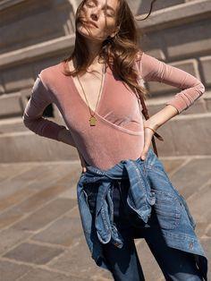 madewell velvet wrap bodysuit worn with the wide-leg jeans + denim chore coat.