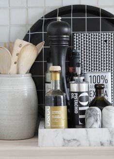 Home Decor Ideas - 6 Ways To Use Serving Trays In Your Decor // In the kitchen, decorated with a oils, vinegars and salt'n'pepper shakers.