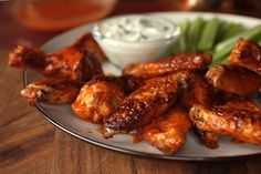 Easy Buffalo Wings quick easy and very good thumbs up at my house. Place 1 cup of hot sauce, 1/2 c buttermilk, and 1/2 tsp garlic powder in a large resealable plastic bag and stir to combine. Add 3lbs wings; seal the bag,  coat the wings evenly. marinate in the refrigerator, 2 hours or more, Remove wings from the marinade, BROIL wings 12 mins on each side, combine 1/2 cup hot sauce and melted butter Add cooked wings, toss to coat. serve with favorite dressing.