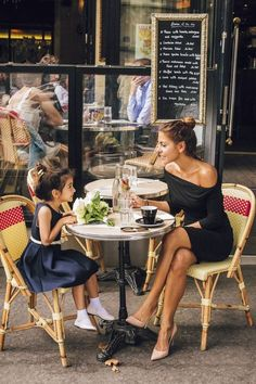 Mother and daughter at a French restaurant