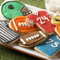 Get creative for game day...there is more to sports than the ball! Cute for an end of season party...pipe the kids name on jersey cookies!