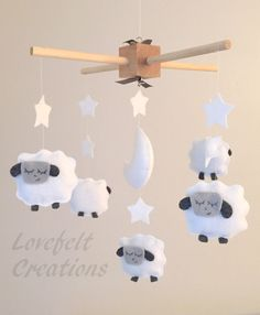 Baby Crib Mobile - Sheep Mobile - Lamb Mobile - by lovefeltmobiles on Etsy https://www.etsy.com/listing/240415694/baby-crib-mobile-sheep-mobile-lamb