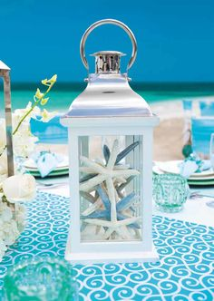 9 Simple Ways to Pull Off a Cool Beach Wedding--lantern starfish wedding decorat. 9 Simple Ways to Pull Off a Cool Beach Wedding--lantern starfish wedding decorations, wedding centerpieces for summer se. Beach Wedding Centerpieces, Beach Wedding Reception, Wedding Lanterns, Seaside Wedding, Beach Wedding Favors, Wedding Ideas, Nautical Table Centerpieces, Decor Wedding, Wedding Ceremony