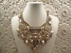 Light gold & pearl vintage collage necklace...recycled components & a pretty detailed center brooch...
