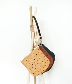 The Convertible Dot Pouch can now be used with the new leather and brass wristlet.