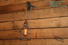 Industrial Pulley Wall Sconce for your Trouble Light Pendant - Trouble Light Fixture not included by IndustrialRewind on Etsy https://www.etsy.com/listing/185675958/industrial-pulley-wall-sconce-for-your