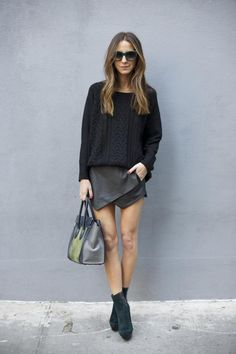 lose jumper with short angled skirt