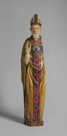 Blessing Bishop (Saint Nicholas of Bari)1350-1375Date: ca. 1350–75 Geography: Made in probably Umbria, Italy Culture: Central Italian Medium: Poplar, paint, gilt Dimensions: Overall: 73 1/2 x 17 1/2 x 13 1/2 in., 39lb. (186.7 x 44.5 x 34.3 cm, 17690.3g) Classification: Sculpture-Wood Credit Line: The Cloisters Collection, 1925 Accession Number: 25.120.218