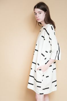 Uzi NYC Now Dress in broken stripe. We love the easy, effortless style of Uzi's printed cotton pieces, with bold geometric designs that are at once minimalist and statement-making. This effortless, li