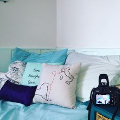 """Getting ready to update my shop with a photo like this one! Pillows featured in this photo are my Long Distance Pillow, Live Laugh Love Pillow, Paris Lace """"Tres Chic"""" Pillow, and Purple Novelty Decorative Pillow, all available for purchase in my shop!"""