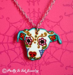 Sugar Skull Pit Bull Dog Necklace - 5 dollars from Every necklace sold will go to Villalobos. $19.95, via Etsy.