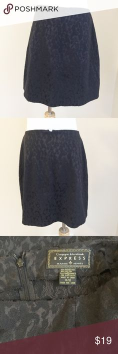 """✨Vintage✨ Express 90's black brocade miniskirt Vintage early 90's-era Express black stretch brocade skirt.  Vintage size 11/12, measures to current 6/S-M, please use measurements for fit.  Hits well above the knee, back zip closure, tailored style.  Condition:  very good vintage.  Material:  55% polyester/42% cotton/3% lycra spandex.  Measurements (approximate, taken laying flat):  length 17"""", flat waist 15.5"""", flat hip 20"""". Vintage Skirts Mini"""