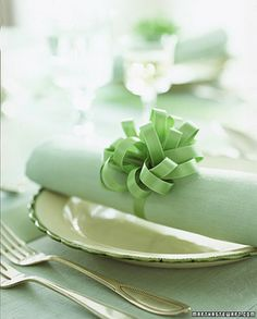 If you like ribbons or something decorative to go on your napkins, roll the napkins up and (as a ribbon example) use curling ribbon of your choice and then just use scissors to curl the ends to make it look stunning: people will think you worked for hours when really it doesn't take that long!