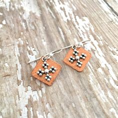A personal favorite from my Etsy shop https://www.etsy.com/listing/265280548/hammered-cross-earrings-copper-and